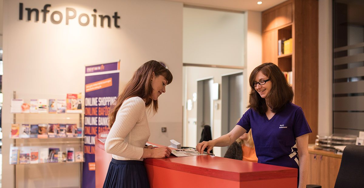 a student gladly receives first-level information at a service and information point from the student services